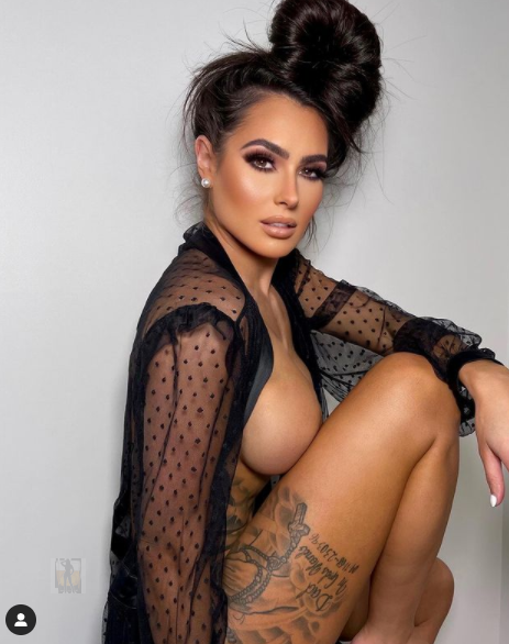 She Flaunts Her Ample Assets While Posing in VERY Skimpy Cage-Style Lingerie